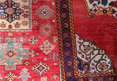 Two Colored Oriental Rugs